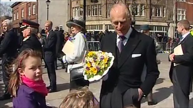 Prince Philip greeting children