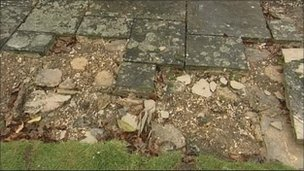 Damaged paving slabs