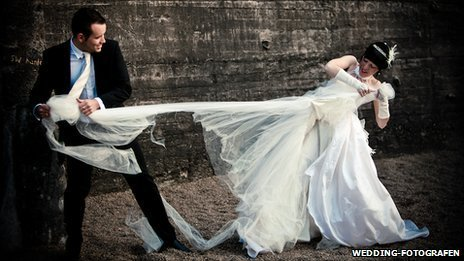 "Groom tearing bride's dress in ""trash the dress"" photoshoot. Pic: wedding-fotografen.at"