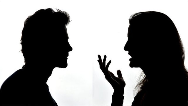 Female and male profiles in silhouette