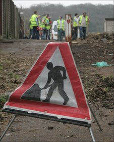 People cleaning up fly-tipping on a footpath