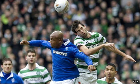 El-Hadji Diouf of Rangers and Celtic's Joe Ledley challenge for the ball