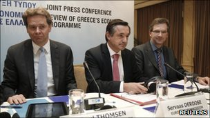 The ECB's Klaus Masuch (R), the EU's Servaas Deroose (C) and the IMF's Poul Thomsen