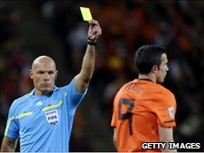 Referee Howard Webb shows a yellow card during the 2010 FIFA World Cup Final
