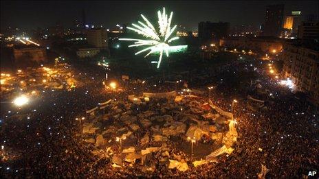 Egyptians set off fireworks in Tahrir Square, in Cairo, Egypt, 11 February 2011