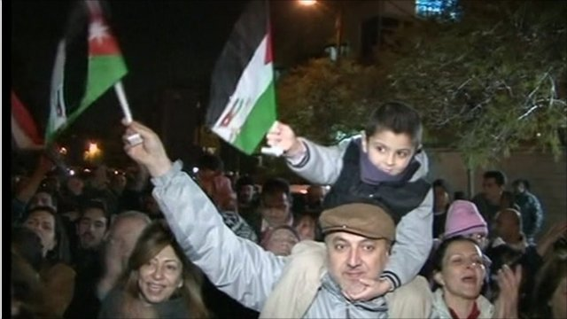 Father and son celebrating in the street