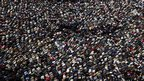 Anti-government protesters in Muslim Friday prayers in Tahrir Square, Cairo, Egypt, 11 February 2011