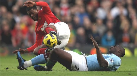 Micha Richards, Manchester City, tackles Patrice Evra, Manchester United