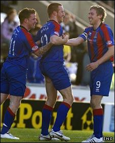 Adam Rooney (centre) celebrates in Paisley