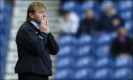 Stuart McCall looks concerned at Ibrox