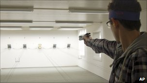 A man fires a pistol at a shooting range near Bern, Switzerland - 6 January 2011