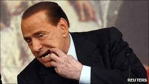 Silvio Berlusconi shows his teeth during a news conference in Rome, 9 February 2011