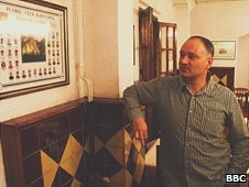 La Masia director Carles Folguera surveys a picture of graduated classes in the dining room