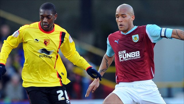 "Watford""s Marvin Sordell and Burnley""s Clarke Carlisle"