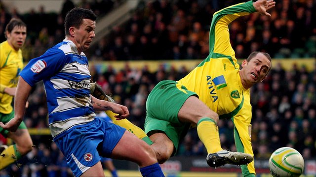 Norwich's Aaron Wilbraham shoots under pressure from Ian Harte
