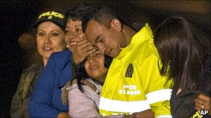 Carlos Ocampo hugs his family at Catama airbase in Bogota