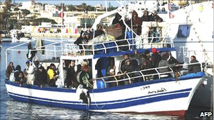 Migrants from Tunisia arrive on Lampedusa on crowded boat, 13 Feb 11