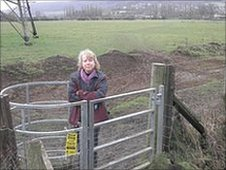 Alison Millar at a kissing gate in Bathford