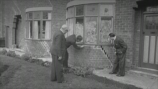 Damaged houses in the 1950s