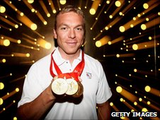 Sir Chris Hoy with his gold medals from Beijing 2008