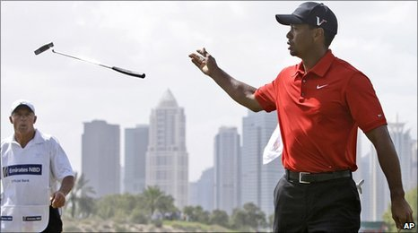 Tiger Woods throws a club to caddie Steve Williams