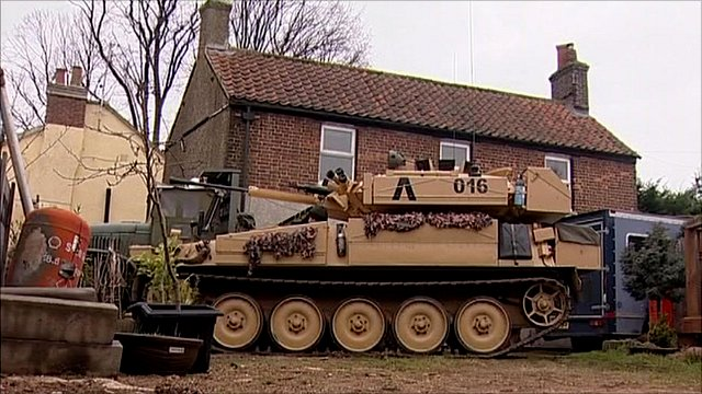The man with a tank in his garden