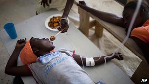 Janika Faneus, receiving treatment for cholera at a MSF, Doctors Without Borders cholera clinic in Saint-Marc, Haiti