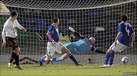 Mark Quigley's shot beats Linfield keeper Alan Blayney to put Dundalk 2-1 up at Windsor Park