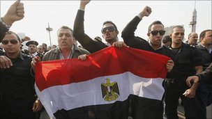 Egyptian policemen stage a protest in Tahrir Square. 14 Feb 2011