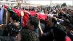 The body of a man killed on Monday is buried in Bahrain (15 February 2011)