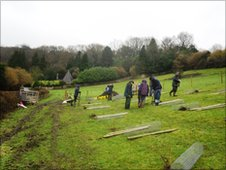 Volunteers planting a community nuttery at Smallcombe Vale, Bath