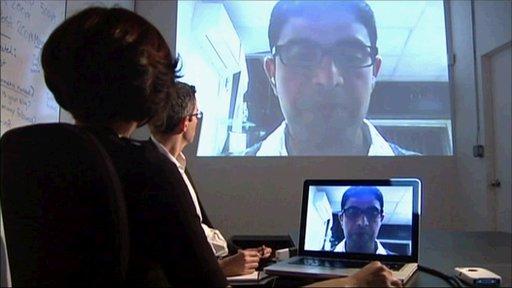 People talking via Skype