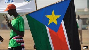 A man holds a SPLM flag in Juba - 30 January 2011