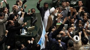 Members of the Iranian parliament protest against opposition leaders following anti-government protests