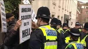 Police with protesters in Luton, March 2009