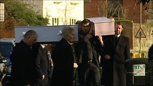 Coffins arrive at church