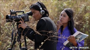Bhutanese cameraman on location