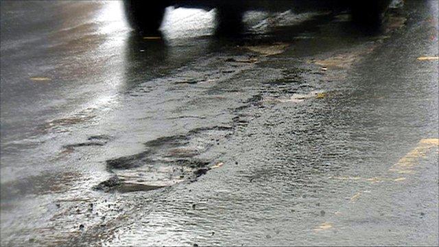 Potholes in a road