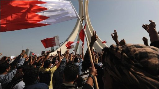 Bahraini protesters wave the national flag