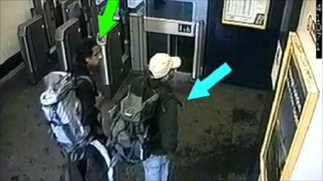 Security camera image with arrows indicating two men carrying rucksacks.