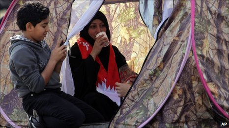 Protesters in Bahrain take a brake inside a tent (16 February 2011)