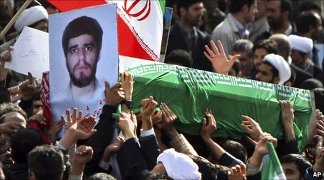 A coffin holding the body of the student Sane Jaleh, killed in Monday's protests in Tehran, is carried by government supporters (16 February 2011)