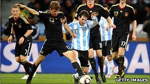 Messi (stripes) in action for Argentina against Germany in the 2010 World Cup