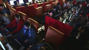 People use computers at an internet cafe in in central China&#039;s Anhui province