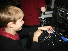 A pupil tries his hand at the school's new broadcast kit