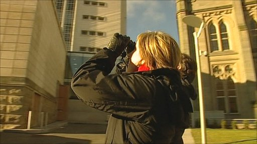 Sally Pepper looks for peregrine falcons from the base of the Newton Building in Nottingham city centre