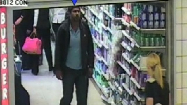 Security camera image of Hussain in a shop