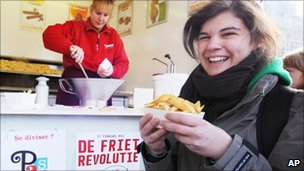 A student with chips in Louvain-la-Neuve