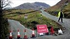 Pc Russell Gee mans a roadblock near Seathwaite in Cumbria's Duddon Valley
