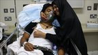 Mother comforts son in Manama